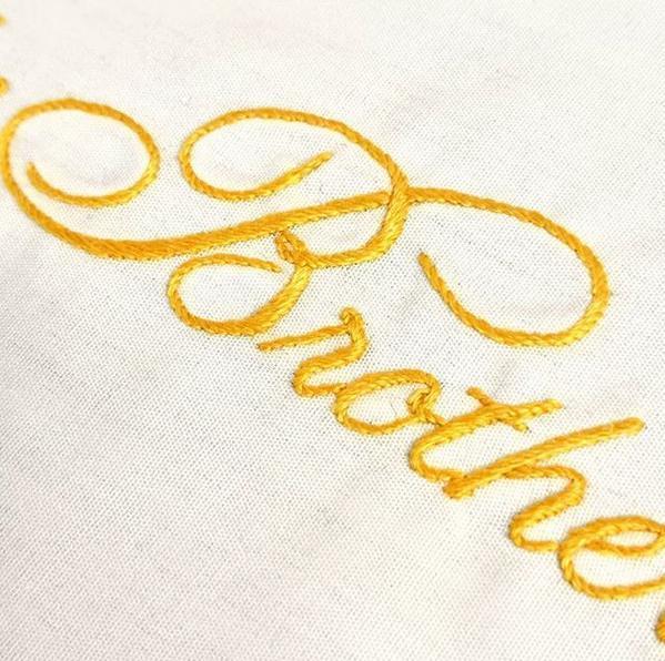 monogram, monogramming, lettering, yellow monogram, stitching, yellow stitching