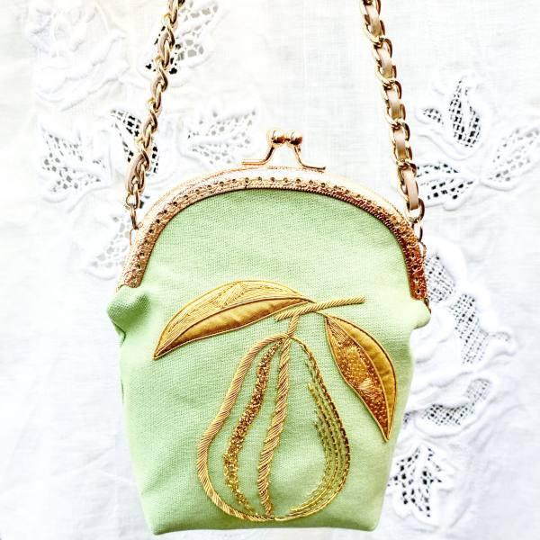 goldwork, gold work, bag, small bag, pear, embellishment, embroidery, chipping, padding, bag, green bag, clasp, bag clasp, product outcome, final outcome,