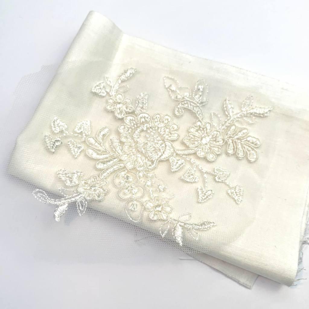 white cord lace, white folded fabric,